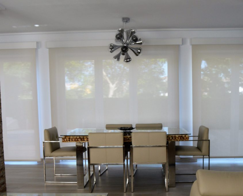 Screen roller blinds defuse light with high gloss wooden pelmets