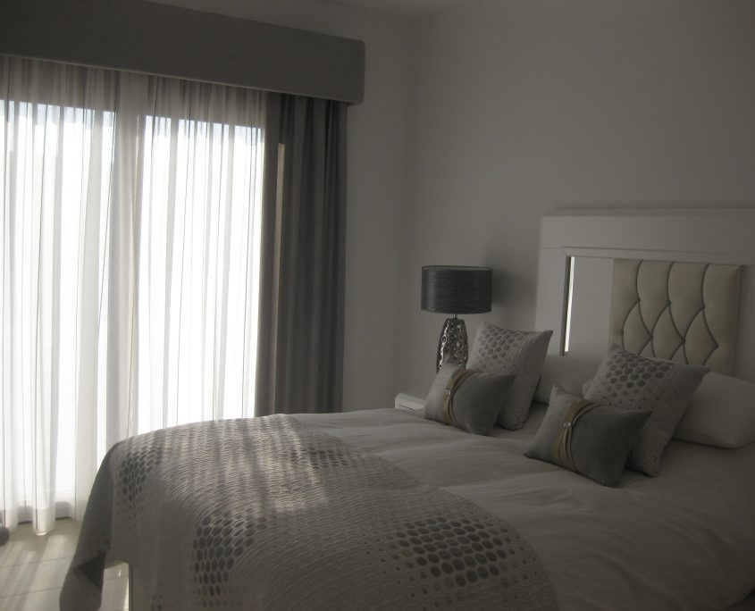 Upholstered pelmet and matching bed linen & cushions look stunning